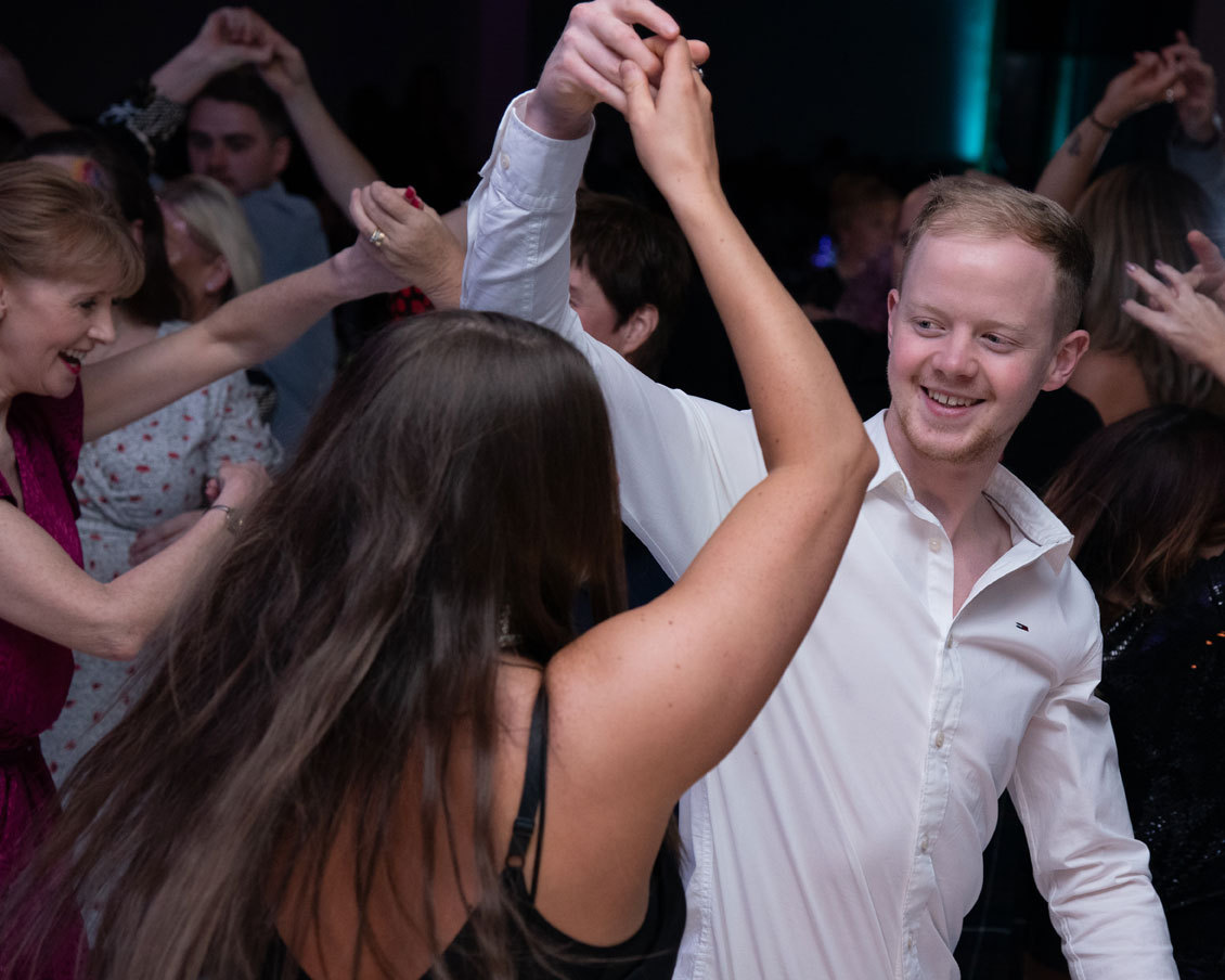 Fundraisers dancing at charity fundraiser for Cystic Fibrosis