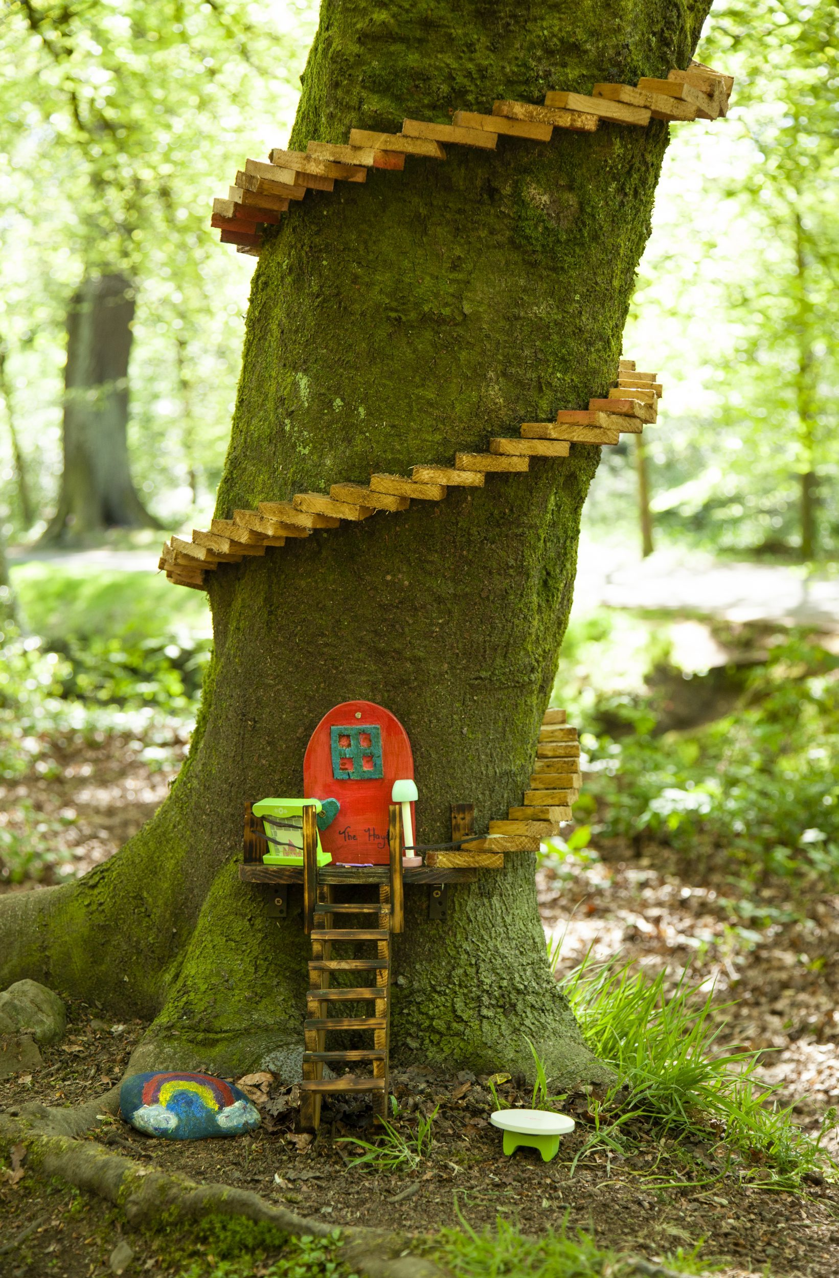 fairy door with staircase at bottom of tree