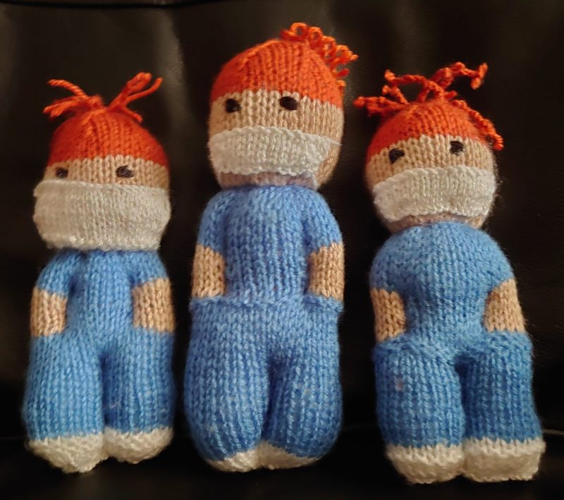 three knitted nurse dolls