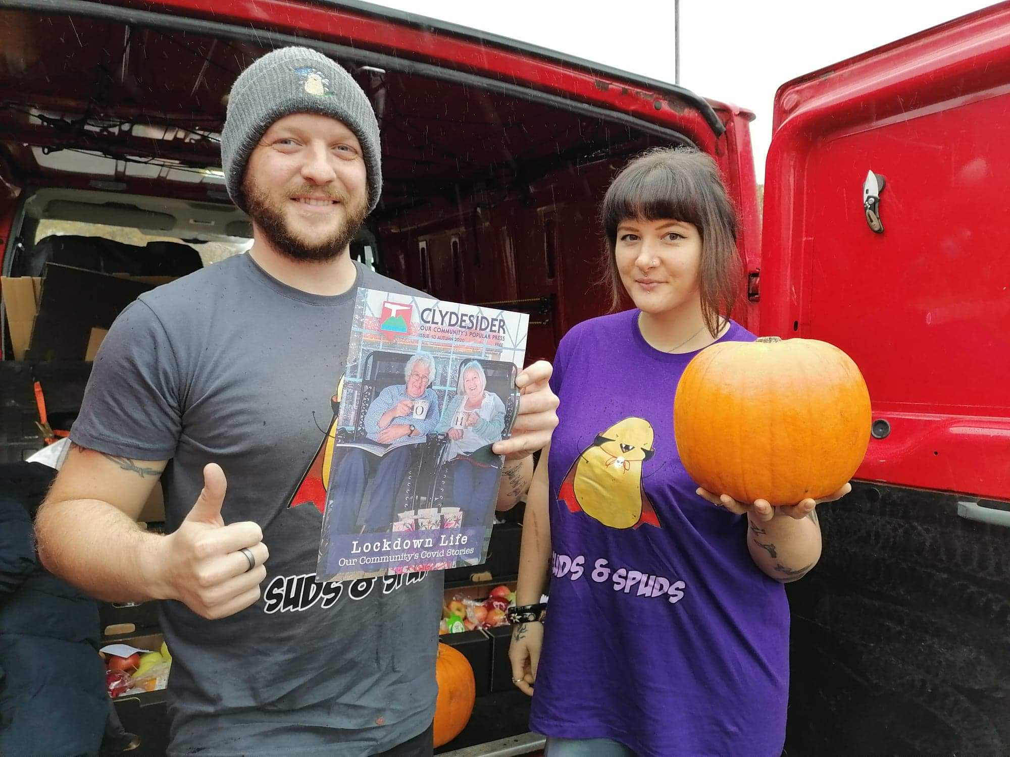 Creag and Laura from Suds and Spuds with a copy of Clydesider and a pumpkin