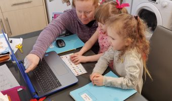 Annemarie Stewart homeschooling at computer with her daughter and friend