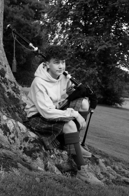 Mark sitting on a tree