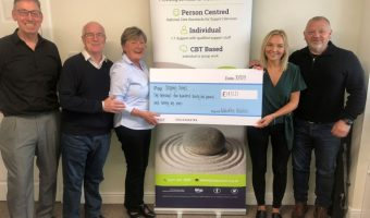 Stepping Stones board members receiving a cheque